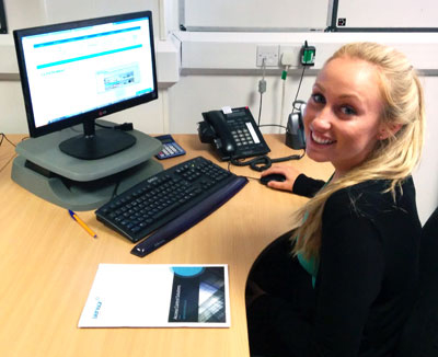 Image of one of our new staff members - Nadia at her desk