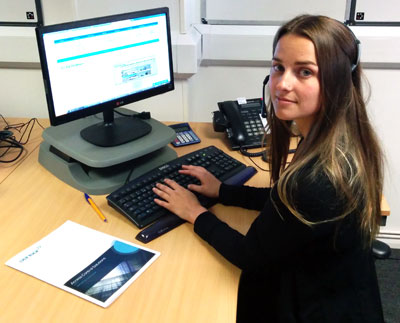 Image of one of our new staff members - Suzi at her desk