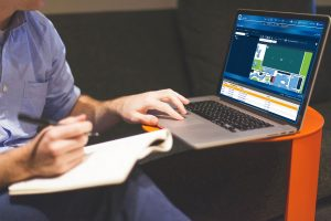 Man on computer using GuardPoint Pro - making better use of your access control system